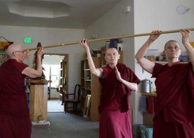 nuns holding a pole up