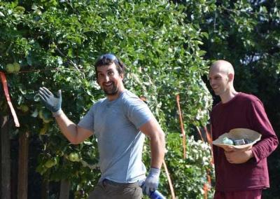 Ryder and Ven. Choepel rejoice at harvesting apples.
