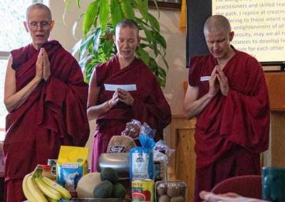 Monastics receive the food offering from our lay friends.