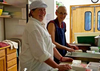 Tracy volunteers to help Ven. Tsepal and others to cook for so many guests.