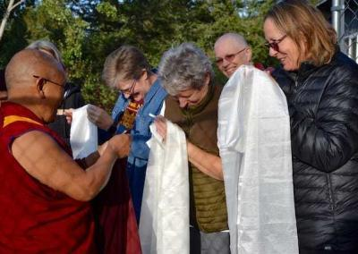 Geshe Dadul says goodbye to the very thankful guests.