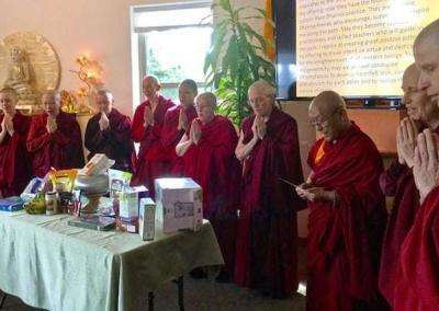 The sangha community receives food offerings from the guests and replies with a prayer to repay their kindness.