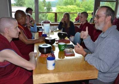 Ven. Losang, Dennis, and others take the opportunity to discuss the teachings with great enthusiasm.