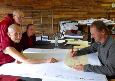 Vens. Chodron, Tarpa, Damcho, and Samten meet with the architect Tim Wilson to work on the design of our future Buddha Hall.
