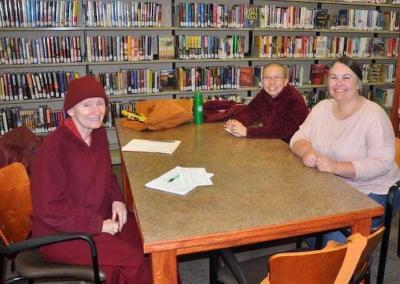 Vens. Samten and Damcho head to the Newport Public Library for ideas in designing the resident library in the new Buddha Hall.