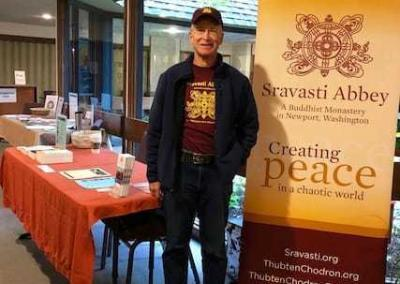 Ken manages the Abbey table at the Spirit and Environment Festival in Spokane.
