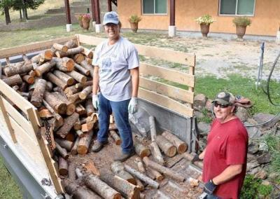 Janet and Dave use their great strength and joy to help with moving wood for the furnace in Ananda in preparation for winter.