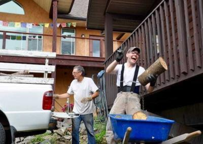 Daniel and Joseph have a good time with moving wood.