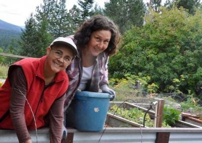 Ven. Nyima and Patricia take time in the garden to harvest and clean up the beds.