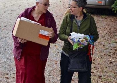 Ven. Yeshe welcomes Claudia, a new guest to the Abbey, who also brought a food offering for our pantry.