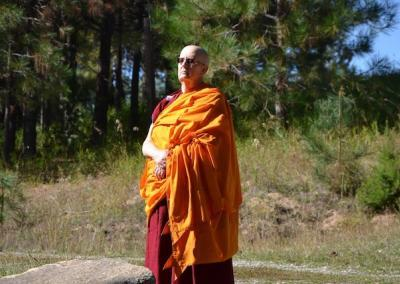Ven. Jigme is thoughtful in the sun.