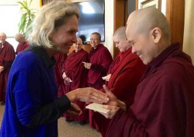 Jen, visiting from Australia, makes kind offerings to the sangha.