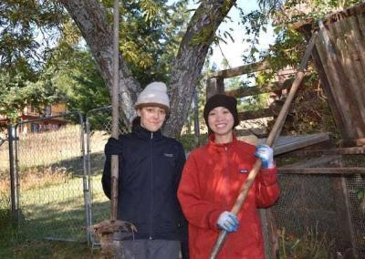 Sydney and Ven. Thuc help by turning the compost.