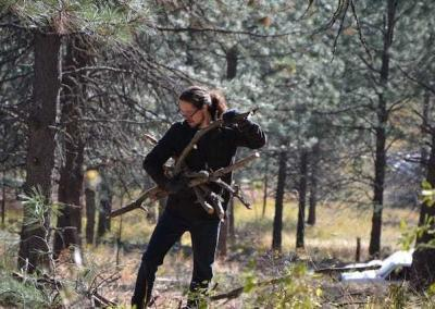 Skyler goes all out in the forest, breaking up bigger branches into smaller parts.