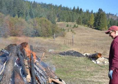 Ven. Tsepal tends the fire that keeps the forest free of dry and non-chippable wood.