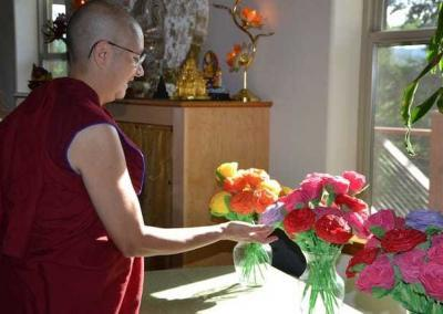 Ven. Nyima enjoys the beautiful paper flowers created and offered by the Dharma group at Coyote Ridge Correctional Center.