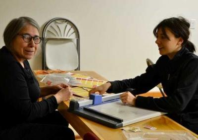 Gizelda from Brazil and long-term guest Sydney prepare Mani pills for Ven. Chodron's travels.