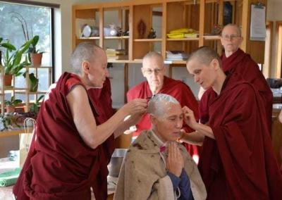 First, Abbey monastics help with the head shaving ceremony.