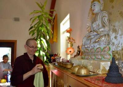 Ven. Tsepal makes offerings to the Buddha with great care and love.