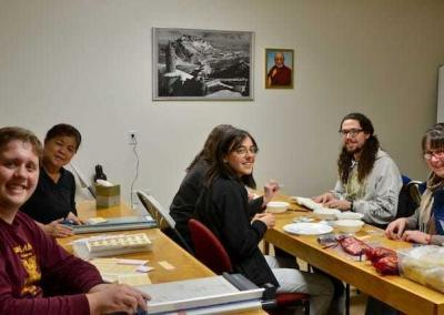 Tanner, Chris, Dana, Sydney, Skyler and Traci assemble bags of mani pills for Ven. Chodron's teaching tours.