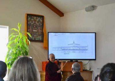 Ven. Chodron presents the architectural drawings for the new Buddha Hall to an enthusiastic audience.