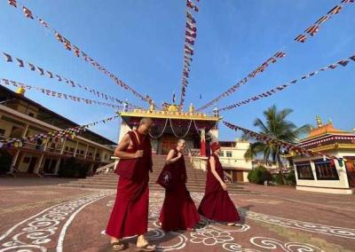 Geshe Gendun Samdup, Serkong Rinpoche's attendant and a veteran of temple construction, leads the nuns on a tour of the nearby Nyingma monastery.