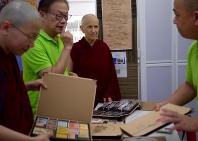 Mr. Leong Kok Hing shares with the nuns about his 40-year-old Buddhist stamp collection that is now housed in the World Buddhist Stamp Gallery.