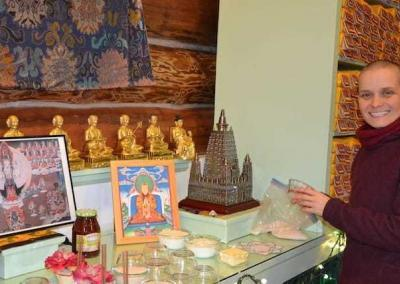 Ven. Jampa helps set up the altar for the retreat.