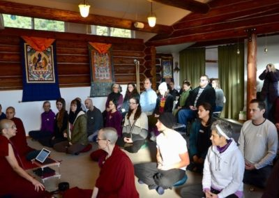 Guests fill the hall and prepare to meditate on the kindness of others.