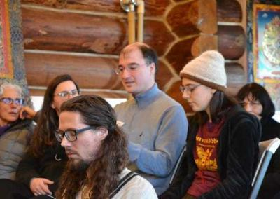 Guests listen and ask questions during the Dharma talk.