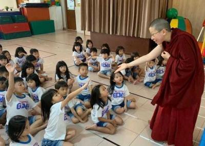 Ven. Damcho shares Buddhist stories with the kids at My Little Gems Buddhist Preschool.
