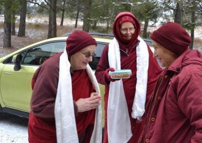 Vens. Jigme and Tarpa welcome Ven. Chodron back to the Abbey in the name of all residents and guests.