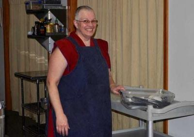 Ven. Yeshe offers her service in the kitchen with great joy.