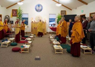 The puja begins as Ven. Chodron makes three bows before the Three Jewels.