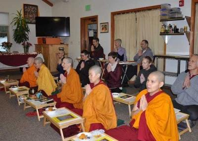 Sangha and guest join in a joyful offering ceremony