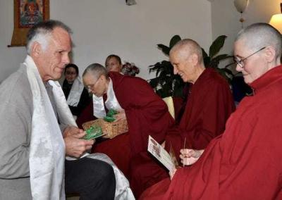 Bill – who was on retreat for the first time – receives a gift and Buddha Hall calendar and mantra card from Vens. Chodron and Chonyi.