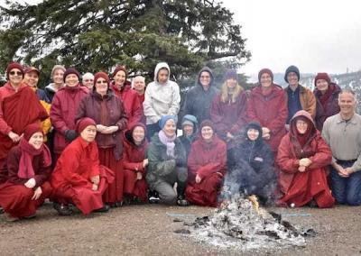 The participants are joyful after the fire puja, knowing we have purified many negativities.