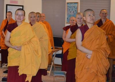"Residents and guests await Ven. Chodron for the weekly Friday teachings: ""May all beings meet the Buddha."""