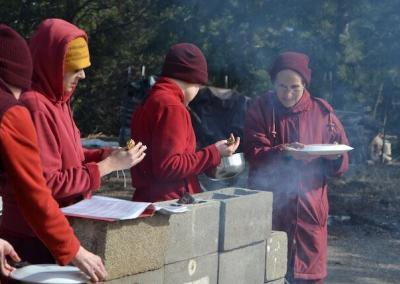 Ven. Chodron guides Vens. Nyima and Lamsel through their fire puja.