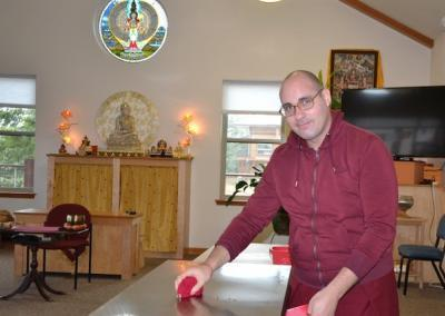 "Ven. Donyo helps with cleaning after lunch: ""May all beings win the bliss of a Buddha."""