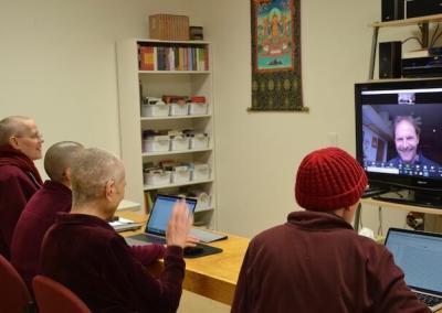 Nuns on call with architect for Buddha Hall.