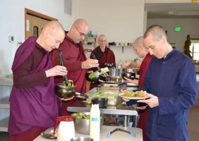 Monastics eat lunch to celebrate end of Versa.