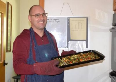 Monk cooks vegetables.