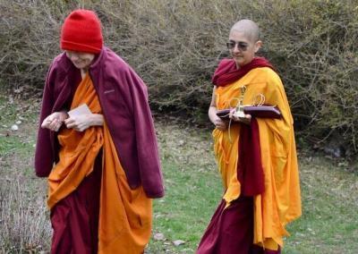 Nun escorts teacher.
