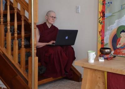 Nun uses computer.