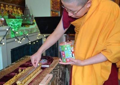 Nun offers incense.