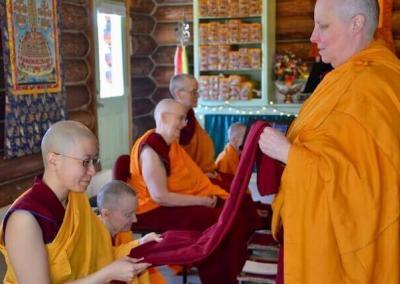 Nun inspects robe of merit.