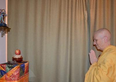 Nun pays homage too bodhisattva.