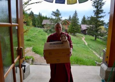 Nun moving with belongings.