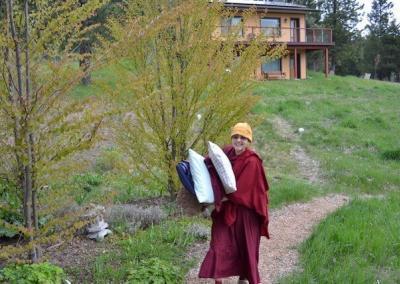 Nun moving with pillows.
